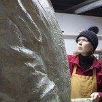 artist ellen scobie at work on statue
