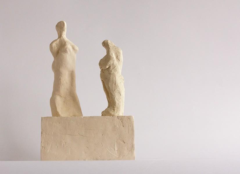 contemporary figurative sculpture in terracotta of two figures in conversation by vancouver sculptor ellen scobie