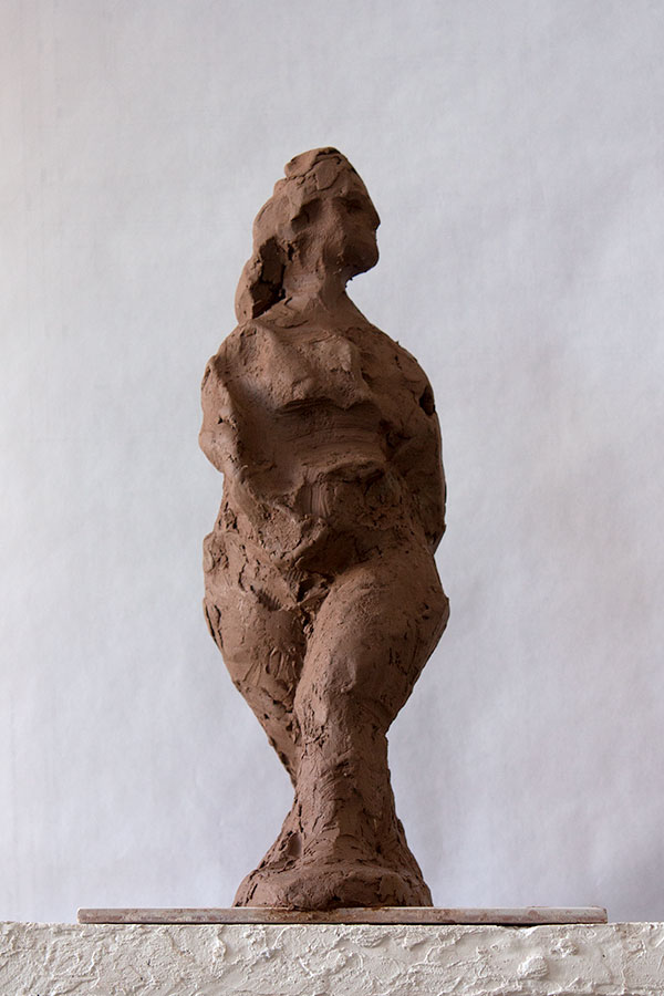 walking figurative sculpture in clay