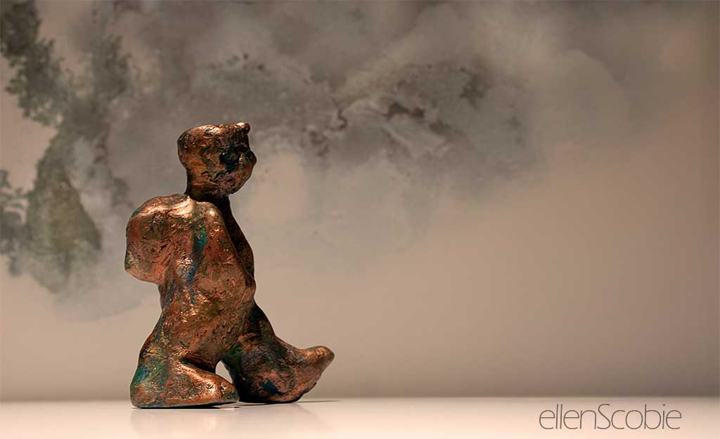 small terracotta sculpture with bronze finish of child