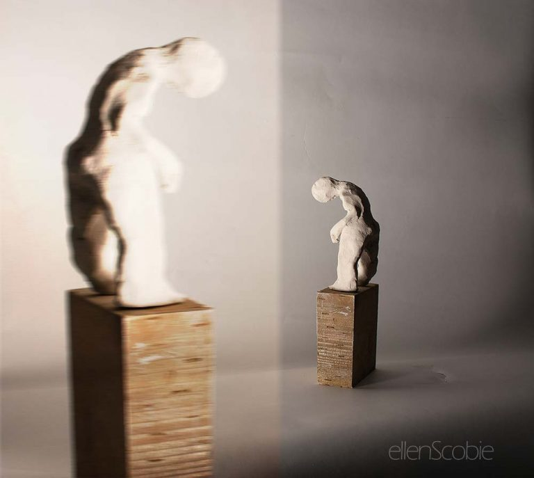 small figurative maquette bending over standing on base